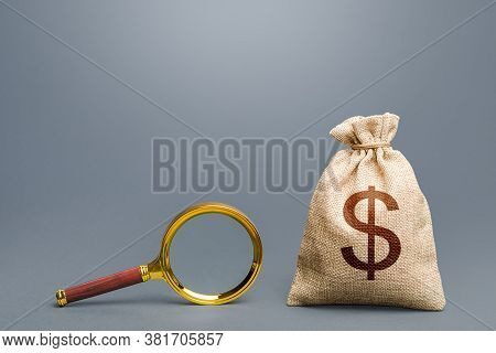 Dollar Money Bag And Magnifying Glass. Financial Audit. Origin Of Capital And Legality Of Funds. Sea