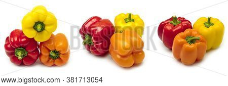 Multicolored Bell Peppers On A White Background. Red, Orange And Yellow Bell Peppers.