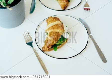 Top View Of A Croissant Sandwich On A Plate.
