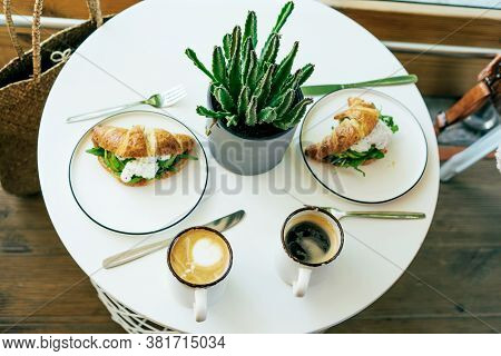 Served Table For Two, Breakfast In The Cafe With Cruzan Sandwiches And Strong Coffee.