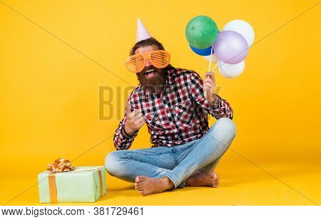 Feel The Success. Cheerful Man In Bday Hat Hold Holiday Balloons. Gifts And Presents Concept. Have A
