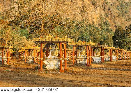 Golden Statues Of Buddhas In Lumbini Garden At The Base Of Mount Zwegabin Near Hpa-an In Myanmar, As