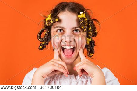Just Have Fun. Hairdressing Tools And Hair Accessories. Kid With Patches On Face. Pose With Hair Cur
