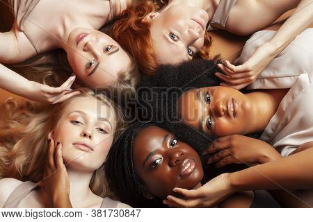 Young Pretty African And Caucasian Women Posing Cheerful Together On Brown Background, Lifestyle Div