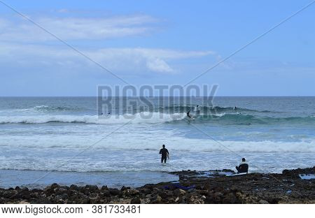 Playa De Las Americas Beach, Tenerife, Canary Islands, Spain, Europe - June 17, 2016 : Surfing On Pl