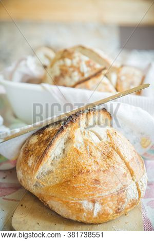 Freshly Cooked White Bread Still In The Bread Pan