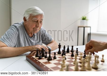 Elderly Senior Playing Chess Table Board Game