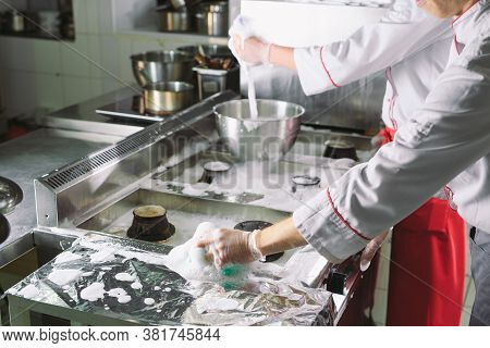 Sanitary Day In The Restaurant. Repeats Wash Your Workplace. Cooks Wash Oven, Stove And Extractor In