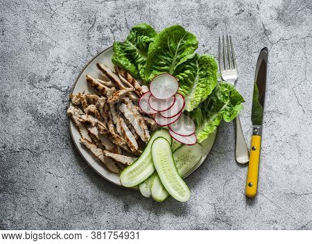 Grilled Chicken, Green Romaine Salad And Fresh Vegetables On A Grey Background, Top View. Diet Balan