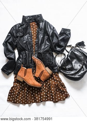 Polka Dot Brown Dress, Windbreaker Jacket, Bag And Chelsea Shoes On A Light Background, Top View. Wo