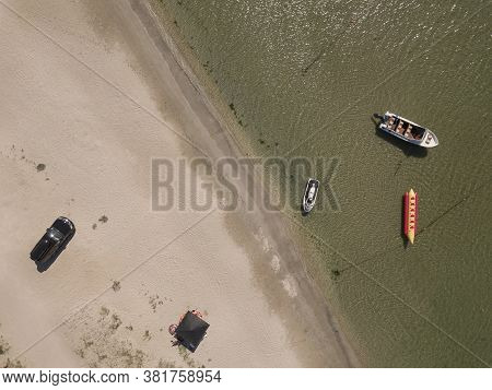 Aerial Top View On The Black Sea Beach. Boats And Water Slides And Atractions.