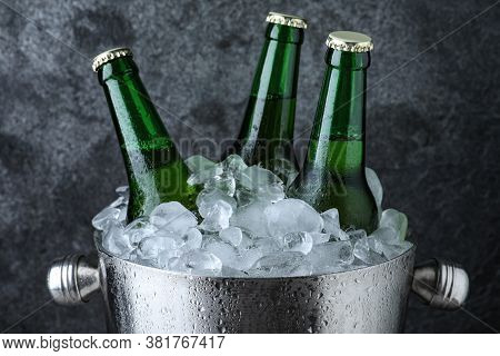 Metal Bucket With Beer And Ice Cubes On Grey Background, Closeup