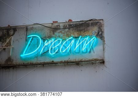 Blue Neon Sign Dream On A Grimy Wall Of London Street