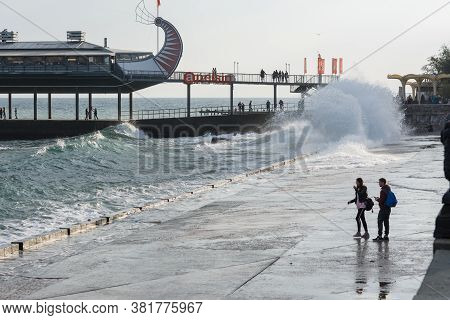 Storm In Yalta On The Embankment Crimea November 5 2018: Storm In Yalta, Breaking Huge Waves Near Em