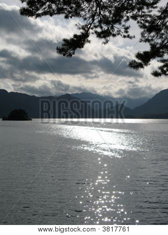 Sun Reflecting Off Lake\'s Surface