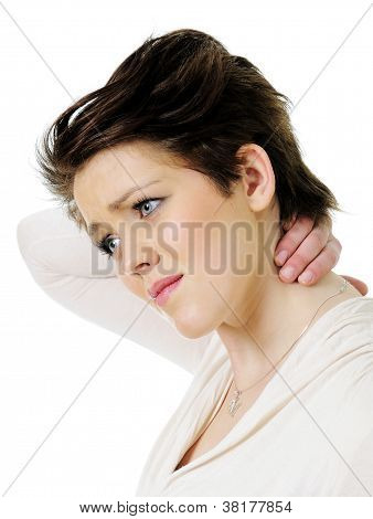 Young woman in pain holding her neck
