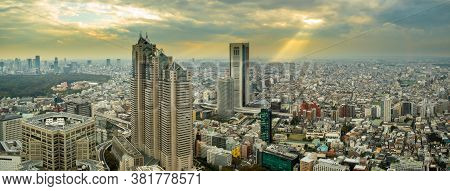 Tokyo, Japan, 11/11/19. Warm Colors Panorama Of Tokyo Before Sunset With Dramatic Cloudy Orange Sky