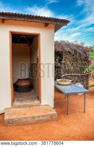 Storage place to make traditional beer from sorghum in a Botswana household in the village