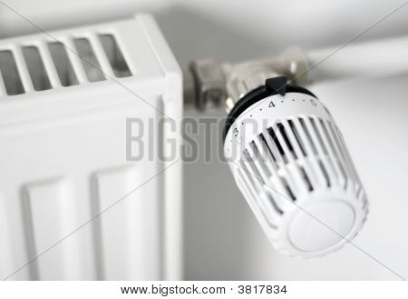 A closeup of a radiator thermostat at home poster