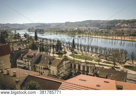 Views Of The City Of Coimbra Portugal From The Hill To The River, Bridge, Park And Historic Building