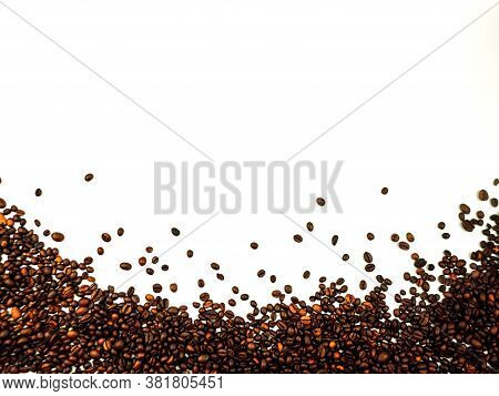 Coffee Beans Scattered On A White Background. Aromatic Arabica On A Background With Copy Space. Mock