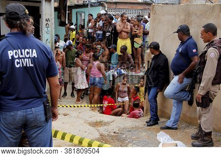 Salvador, Bahia / Brazil - January 22, 2013: Civil Police Investigates The Body Of A Murdered Man In