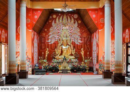 Phayao, Thailand - August 18 2020: Gold Buddha Statue At Chapel In The Pool At Wat Si Khom Kham, Pha