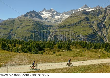 Zermatt, Switzerland - 21 June 2020: People Riding Bikes At Sunnegga Over Zermatt In The Swiss Alps
