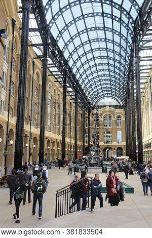 London, Uk - April 23, 2016: People Visit Hay's Galleria In London, Uk. Originally A Warehouse Known