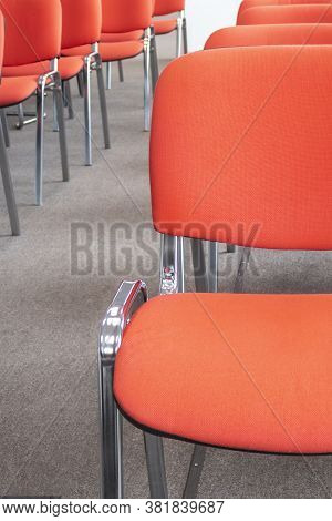 Red Chairs In A Meeting Room. Empty Seats In Auditorium. Selective Focus.