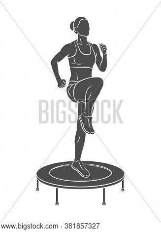 Woman Jumping On Trampoline. Young Fitness Girl Trains On A Mini Trampoline
