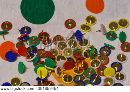 Scattered Thumbtacks On A Colored Plane, Horizontal Image