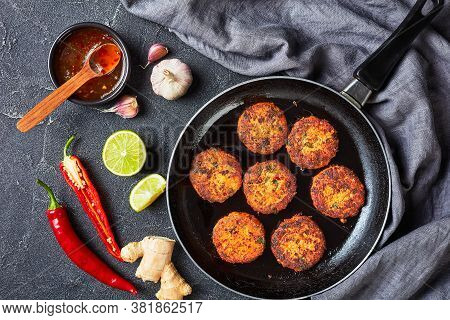 Fried Thai Fish Cakes On A Skillet On A Concrete Table With Sweet Chili Sauce, Horizontal View From