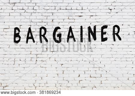 Inscription Bargainer Written With Black Paint On White Brick Wall.