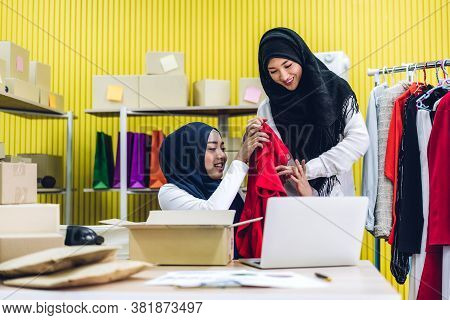 Portrait Of Smiling Beautiful Two Muslim Owner Asian Woman Freelancer Sme Business Online Shopping W