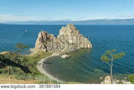 Beautiful Landscape Of Siberian Baikal Lake. Panoramic View Of Shamanka Rock On Olkhon. Cape Burhan.