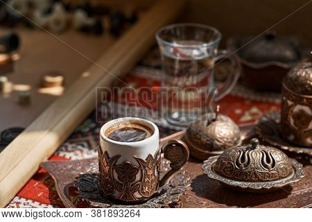 Traditional Turkish Coffee And Turkish Delight Dish On A Copper Tray, On A Tablecloth With A Nationa
