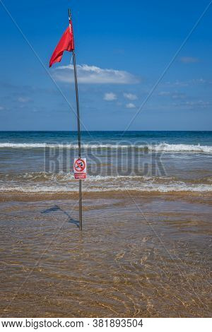 Red Flag On The Beach. Swimming And Surfing Ban
