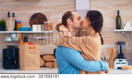 Charming Married Couple Full Of Happiness Dancing In Kitchen. Cheerful Happy Young Family Together D
