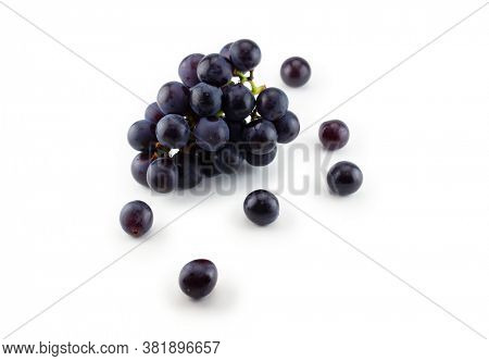 Kyoho grapes (giant mountain grapes) , with some grapes scattered out in front. Isolated on white.