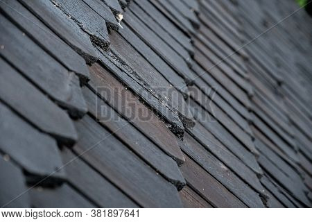 Shingles On The Roof. Wooden Roof, Shingled Roof. Wooden Tile. Roof Of Complex Construction With Dor