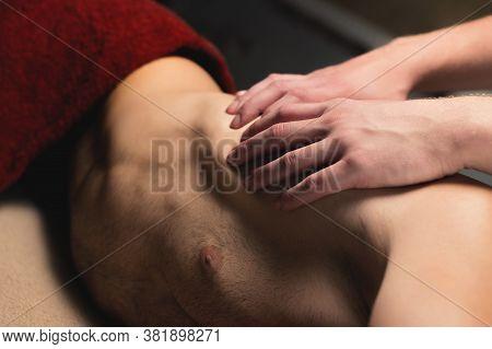 Professional Sports Massage Male Masseur Makes An Athlete A Man. Latissimus Dorsi Lats Massage