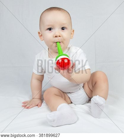 Image Of A Eight Month Old Baby With Bright Rattle