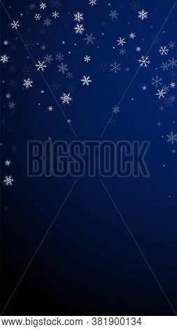 Sparse Snowfall Christmas Background. Subtle Flying Snow Flakes And Stars On Dark Blue Background. A