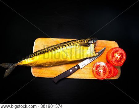 Smoked Mackerel Fish With Tomatoes On A Cutting Board. Salted Mackerel Fish. Canned Food. Food Photo