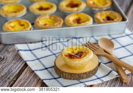 Dessert Egg Tart Or Portugal Egg Tart Sweet Custard Cream On Wooden Board With Wooden Spoon
