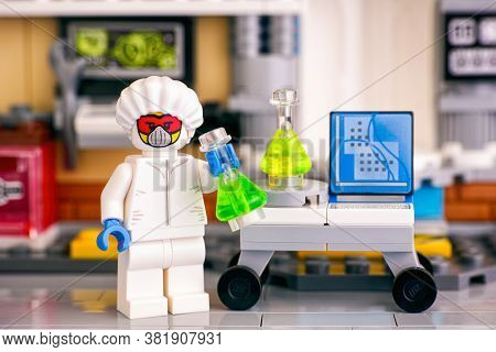 Tambov, Russian Federation - June 08, 2020 Lego Minifigure In Protective Suit With Flasks Making Exp
