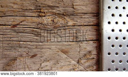 Texture Wooden And Metal Surfaces. Old Wooden Board And Metal Element  With Round Holes