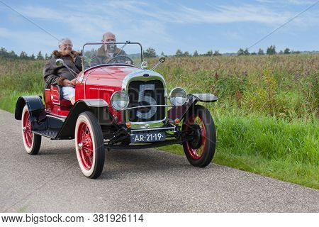 Weerribben, The Netherlands- September 03, 2011: Senior Couple Riding With A Classic Ford Oldtimer T