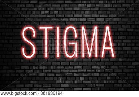 Stigma Glowing Neon Word On Black Brick Wall. Tolerance Concept
